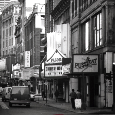 (8) In 1977, David Wong bought the old Center Theater (adult movies) and converted it to the Pagoda Cinema for Chinese movies despite its location between the Pussycat Lounge and the Naked I Cabaret. Boston Globe